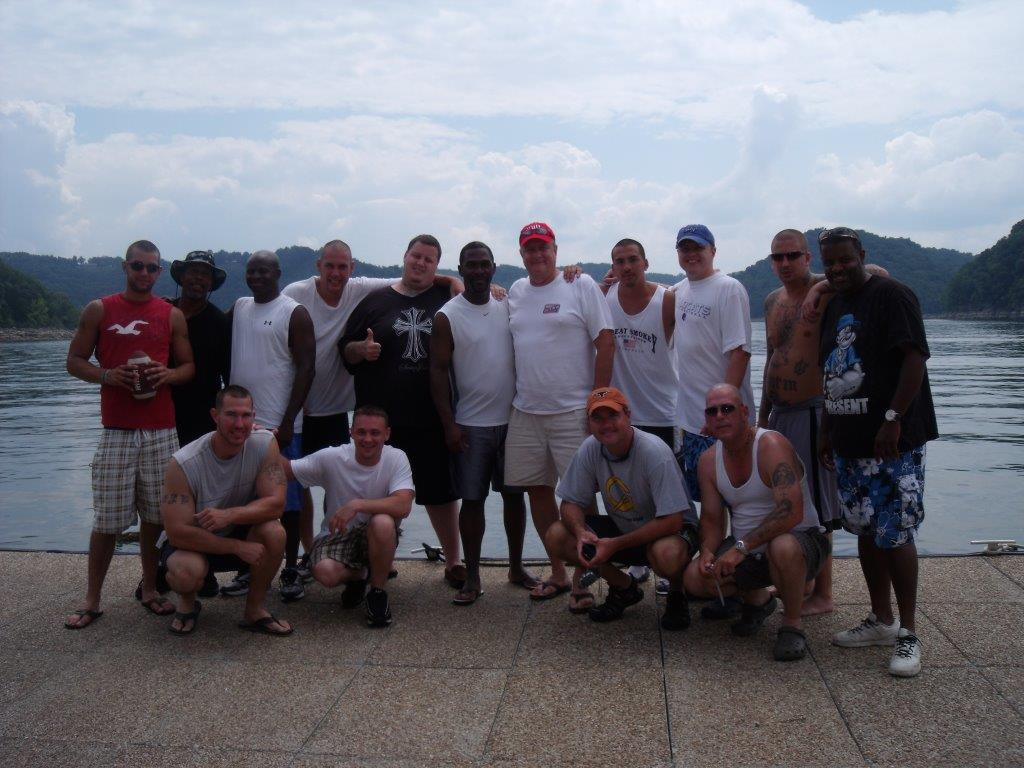 Group shot celebrating Men of Valor Participants on a fun lake day