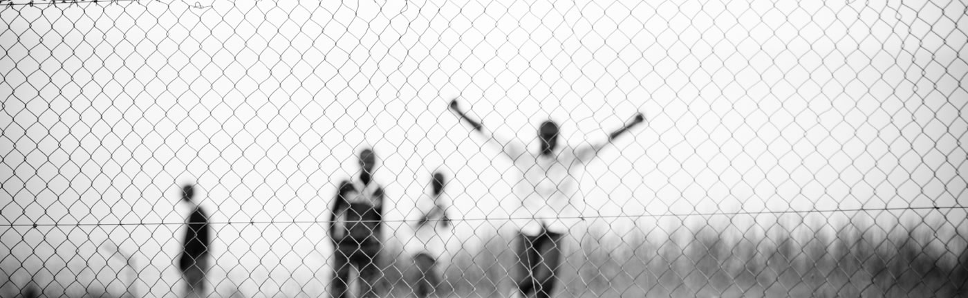 Participants behind fence